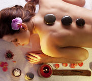 Stones spa procedures. Woman getting stones spa procedures Royalty Free Stock Images