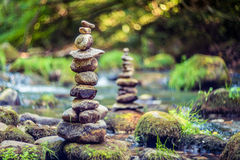 Stones. Stack or tower of zen stones in nature near water, beautiful bokeh Royalty Free Stock Photos