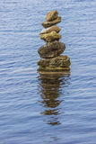 Stones stack in water with reflection Stock Photos