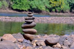 The stones are stacked along the river royalty free stock image