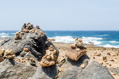 Stones Stacked on Black Volcanic Rock Royalty Free Stock Photography
