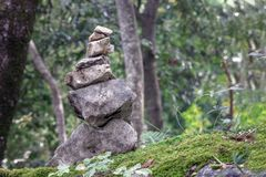 stones stacked in the forest royalty free stock photography