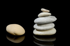 Stones stacked isolated black Royalty Free Stock Photography
