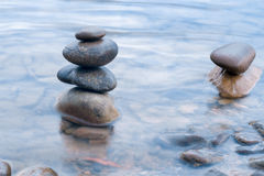 Stones stacked on river scene Royalty Free Stock Image