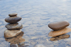 Stones stacked on river scene Stock Photos