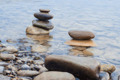 Stones stacked on river scene Stock Images