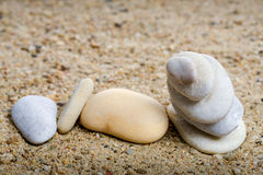 Stones stacked in sand Stock Photos