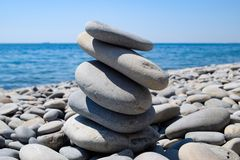 Stones stacked on top of each other against the background of the sea.  royalty free stock photo