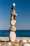 Stones staked in tower on the beach Stock Image