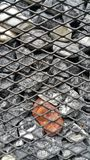 Stones in the steel cage, decorated the wall. Stock Images