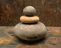 Stones On Stone. Water rounded stones stacked in a stone environment. 1 of 3 image series Royalty Free Stock Photo
