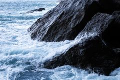 Sea waves during a storm on the Azure shore royalty free stock images