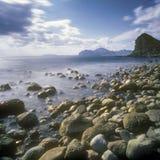 Stones in the surf. Long exposure shot taken near Feodosia, Crimea, Ukraine Stock Photos