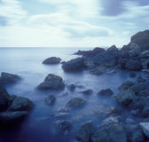 Stones in the surf. Long exposure shot taken near Feodosia, Crimea, Ukraine Royalty Free Stock Images