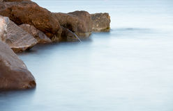 Stones in the surf Royalty Free Stock Images