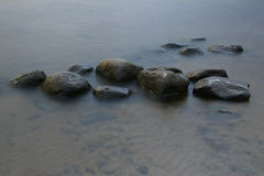 Stones in Surf Long Exposure Photo Stock Photos