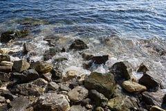 Stones surf. Sea waves on the coast Stock Photo