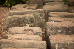 Stones from Temple Ruins of Phnom Bakheng, Angkor City. Stones are ordered and labeled to use to repair the temple of Phnom Bakheng in Angkor City Stock Photos