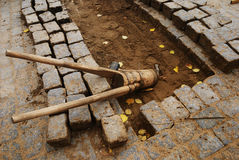 Stones and tools for paving Stock Image
