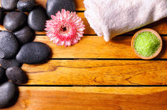 Stones with towel and bath salts top view Stock Photo