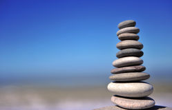 Stones tower on the beach. With blue sky on background royalty free stock images