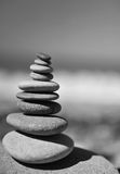 Stones tower on the beach. Monochrome photo of stones tower on the beach stock photography