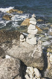Stones tower on pebble beach with Adriatia Sea in the background. Concept of zen, harmony, balance stock images