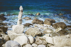 Stones tower on pebble beach with Adriatic Sea in the background. Concept of zen, harmony, balance stock images