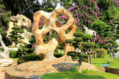 Stones and trees of unusual shape in a landscape park.Thailand stock photos