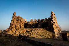 Stones in Tughlakabad, Indian Architecture. Remains of the great city of Tughlakabad, an old, yet destroyed city near New Delhi, India Royalty Free Stock Images