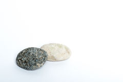 Stones. Two stones on a white background Royalty Free Stock Image
