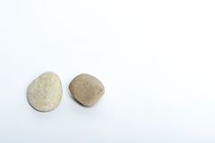 Stones. Two stones on a white background Royalty Free Stock Photos