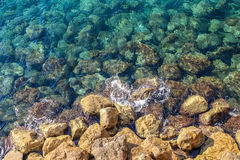 Stones under the water, the beach of the Mediterranean Sea Stock Photos