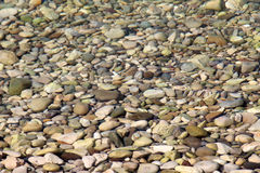 Stones under the water Stock Photography