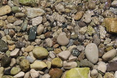 Stones under the water Royalty Free Stock Photo