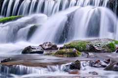 Stones under waterfall Royalty Free Stock Image