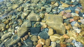 Stones Underwater. Footage of stones underwater distorted by the water surface stock video