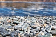 Stones up close at the blue waters stock image