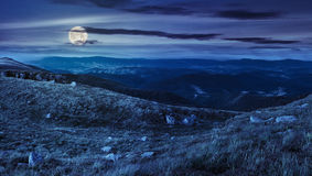 Stones in valley on top of mountain range at night Stock Image