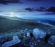 Stones in valley on top of mountain range at night Royalty Free Stock Photos