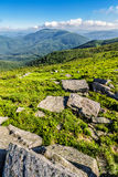 Stones in valley on top of mountain range Stock Images