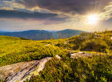 Stones in valley on top of mountain range at sunset Royalty Free Stock Photography