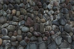 Wall of irregular stones stock image