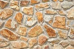Stones wall. Random stones in concrete background Stock Photo