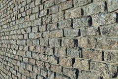 Stones wall from granite bricks Stock Image