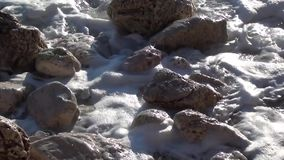 Stones washed by stormy sea stock video