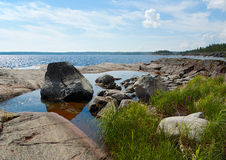 Stones in water. Stones on stone coast of Ladoga lake Royalty Free Stock Photos
