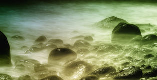 Stones in water. In a long exposure shot Stock Images