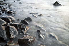 Stones in water. Photographed at long exposure Royalty Free Stock Image