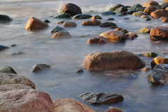 Stones in water. Long exposure shot of some stones in sea stock image